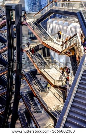 MANHATTAN, NEW YORK, USA - NOVEMBER 6, 2019: Visitors enjoy the morning walk inside the Vessel, the popular landmark of located at the Hudson Yards on the West side of Manhattan.  #1666802383
