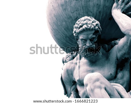 Statue of the Greek God Atlas holding the globe on his shoulders.  With colour toning Royalty-Free Stock Photo #1666821223