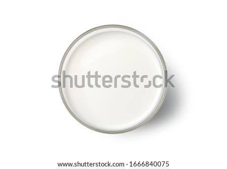 Milk in a glass top view. isolated  on white backgroud Royalty-Free Stock Photo #1666840075