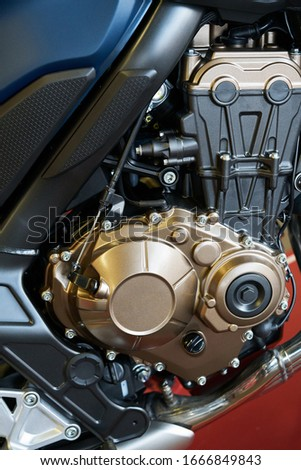 Motorcycle engine close-up detail background. Royalty-Free Stock Photo #1666849843