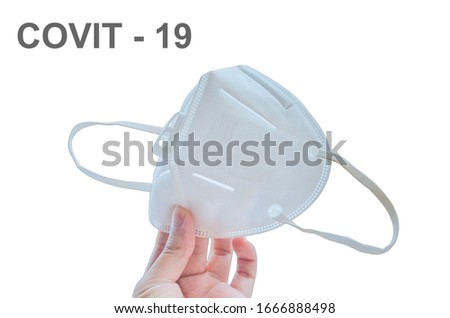 hand holding KN95 or N95 mask for protection pm 2.5 and corona virus(COVIT-19).Anti pollution mask.air face mask with covit-19 word on white background. #1666888498