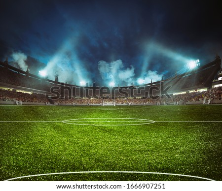 Football stadium with the stands full of fans waiting for the night game Royalty-Free Stock Photo #1666907251