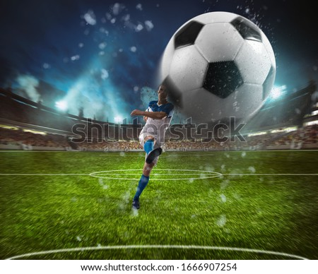 Football scene at night match with player in a white and blue uniform kicking the ball with power Royalty-Free Stock Photo #1666907254