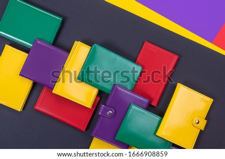 flat lay of bright leather wallets on a matte stylish background Royalty-Free Stock Photo #1666908859