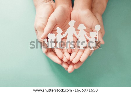 Adult and children hands holding paper family cutout, life insurance planning, adoption, foster care, homeless support, family mental health, family wellness, social distancing concept #1666971658