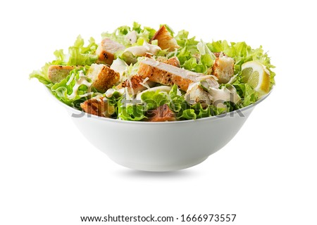 Chicken Salad. Chicken Caesar Salad. Caesar Salad with grilled chicken and croutons. Grilled chicken breast and fresh green salad isolated on white #1666973557