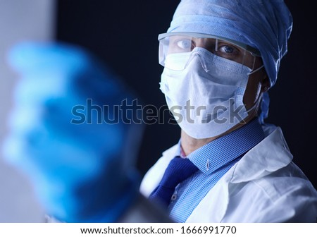 Young doctor looking X-Ray image on isolated white background #1666991770