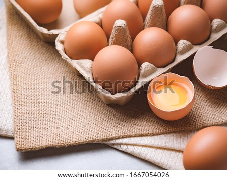 Close up image of organic chicken eggs are one of the food ingredients on the restaurant table in the kitchen to prepare for cookingwith copy space. Organic chicken eggs food ingredients concept #1667054026