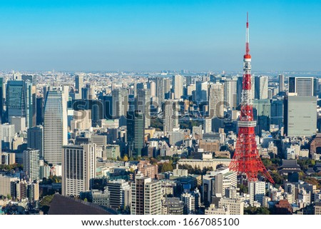 Japan. Tokyo. Tokyo Television Tower rises above the city. Panorama of Tokyo with a television tower. Japanese city top view. Red television tower. Sights of Japan. Japanese city landscape. #1667085100