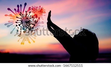 Silhouette Little Chinese girl raised hands for protection virus Covid-19.Kid girl praying in the sunset sky for a new day freedom to corona covid19 virus.Little asian girl hand praying for thank GOD. #1667112511