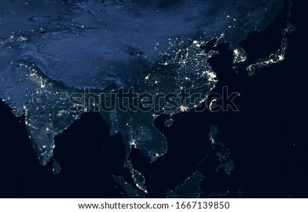 Earth at night, view of city lights showing human activity in India, China, South Korea and Japan from space. World dark map on global satellite photo. Elements of this image furnished by NASA.