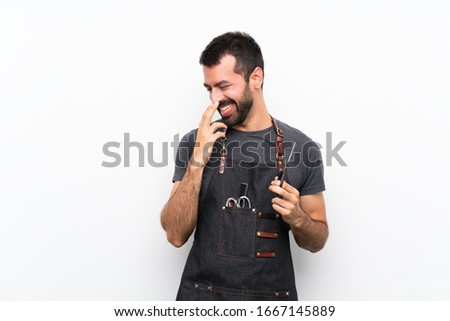 Barber man in an apron smiling a lot #1667145889