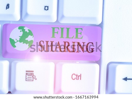 Text sign showing File Sharing. Conceptual photo transmit files from one computer to another over a network. #1667163994