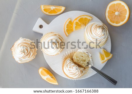 Lemon cupcakes with Italian meringue. Delicious homemade cakes. Top view, close- up, copy space.
