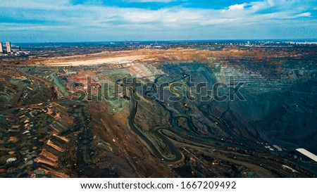 Aerial view of the Iron ore mining, Panorama of an open-cast mine extracting iron ore, preparing for blasting in a quarry mining iron ore, Explosive works on open pit #1667209492