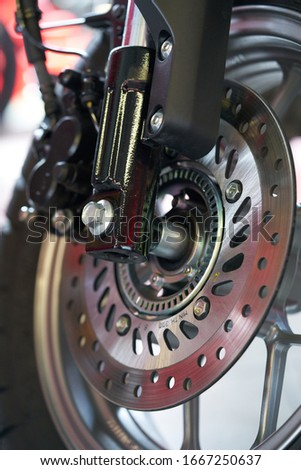 Close-up of motorcycle brakes and front wheel Royalty-Free Stock Photo #1667250637