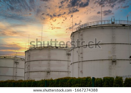 Big industrial oil tanks in a refinery base. Royalty-Free Stock Photo #1667274388