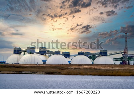Natural Gas Tank in the morning. Royalty-Free Stock Photo #1667280220