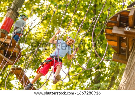 happy little children in a rope park on the wood background #1667280916