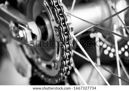 Detail of a motorcycle rear chain. Macro of motorcycle chain. Royalty-Free Stock Photo #1667327734