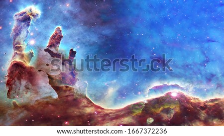 Pillars of creation and space dust in deep space. . Elements of this image were furnished by NASA Royalty-Free Stock Photo #1667372236