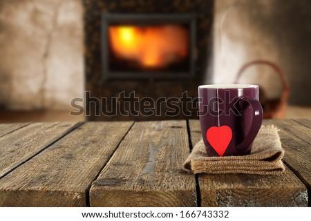 mug of love and fireplace