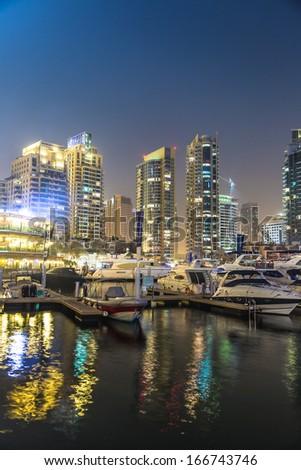 DUBAI, UAE - NOVEMBER 13: Dubai downtown night scene with city lights, luxury new high tech town in middle East. Dubai Marina cityscape,  on November 13, 2012 in Dubai, UAE. #166743746