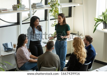Diverse multiracial businesspeople gather at briefing brainstorm discuss company business ideas together, multiethnic colleagues talk consider financial startup project at office meeting Royalty-Free Stock Photo #1667439916