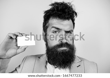 Banking services. confident businessman. blank piece of paper. barbershop concept. best barber master. barber shop for gentlemen. brutal male beauty. serious bearded man business card. copy space.