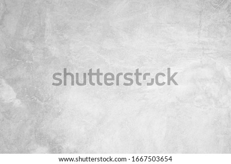 White concrete wall for interior or outdoor exposed surface polished. Cement have sand and stone of tone vintage, Grey natural concrete loft patterns old antique, design work floor texture background. Royalty-Free Stock Photo #1667503654