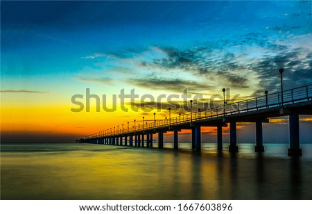 Sunset river bridge sky clouds. RIver bridge sunset scene. Sunset river brisge landscape #1667603896
