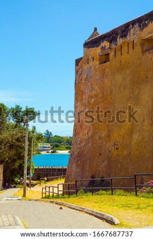 Fort Jesus - fortress with five bastions. Corner bastion and loopholes. Medieval fortification in Mombasa, Kenya. The concept of historical, educational and photo tourism