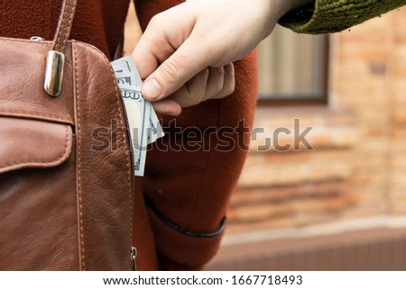 pickpocket thief street criminal action concept picture of male hand try to steal cash money from woman bag  #1667718493