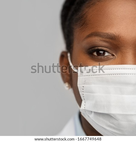 medicine, profession and healthcare concept - close up of african american female doctor or scientist in protective facial mask over grey background #1667749648