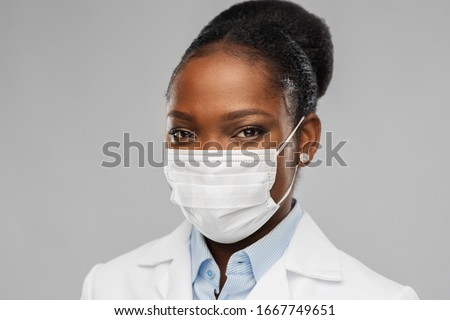 medicine, profession and healthcare concept - african american female doctor or scientist in protective facial mask over grey background #1667749651
