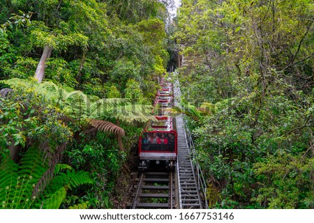 Scenic Railway at the Blue Mountains, Sydney Australia. World heritage Blue mountains with Scenic Railway moving around beautiful landscape. Royalty-Free Stock Photo #1667753146