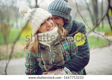 Two embracing couple ,young people , beautiful and happy couple , autumn atmosphere ,colourful pic
