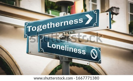 Street Sign the Direction Way to Togetherness versus Loneliness Royalty-Free Stock Photo #1667771380