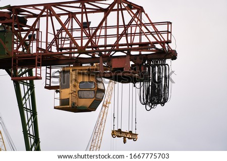 Cargo Cranes in Industrial Port. Royalty-Free Stock Photo #1667775703