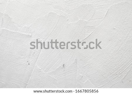Fresh concrete wall in the construction site, gray wall with cement floor, construction background renovation process, abstract Royalty-Free Stock Photo #1667805856
