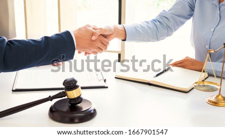 Handshake after cooperation between attorneys lawyer and clients discussing a contract agreement hope of victory over legal fighters  Concepts of law  advice Royalty-Free Stock Photo #1667901547