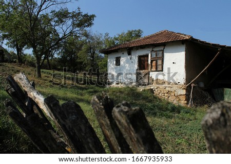 Old abandoned farmhouse and fence #1667935933