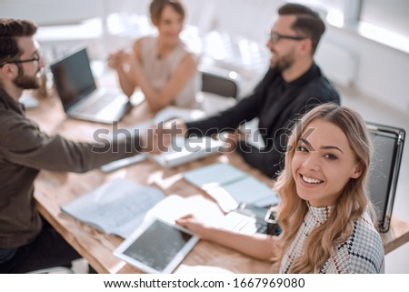 young business woman with a digital tablet at a business meeting #1667969080