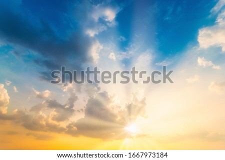 Sky blue and orange light of the sun through the clouds in the sky #1667973184