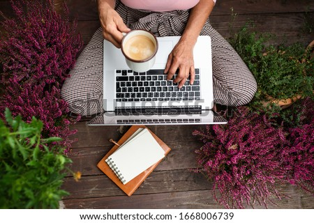 Top view of senior woman with laptop sitting outdoors on terrace, working. Royalty-Free Stock Photo #1668006739