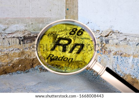 Preparatory stage for the construction of a ventilated crawl space in an old brick building - Searching gas radon concept image seen through a magnifying glass. #1668008443