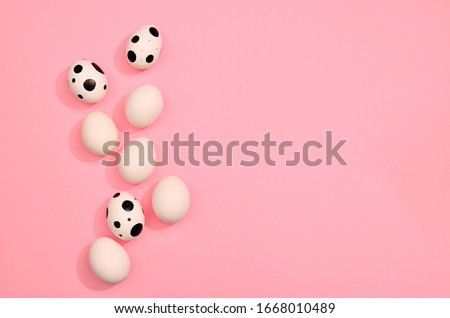 Many White easter eggs pattern on trendy pastel mint blue and pink color background. Eggs are hand drawn. Easter holiday concept wallpaper, gift card for your design, place for text. Flat lay style #1668010489