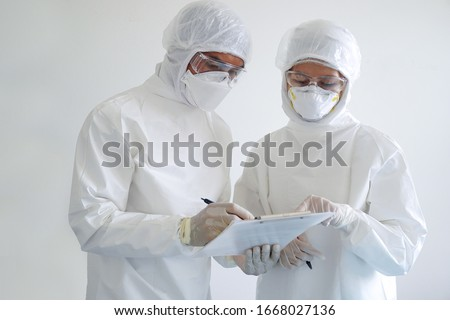 doctor and nurse are wearing PPE and looking for corona/covid-19 virus infected patient's laboratory report #1668027136