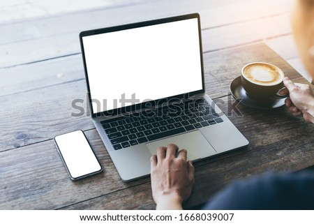 computer,cell phone mockup image blank screen with white background for advertising text,hand woman using laptop texting mobile contact business search information on desk in cafe.marketing,design #1668039007