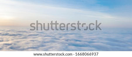 Yellow and blue dawn over clouds, concept, travel and leisure. Royalty-Free Stock Photo #1668066937